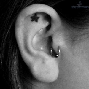 tragus-piercing-and-star-tattoo