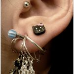 tragus-piercing-and-upper-lobe-piercing-with-kitty-stud